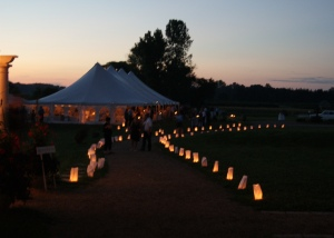 luminary at twilight looking into the reception tent
